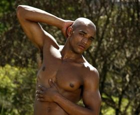 Black muscular stud nude in the outdoor