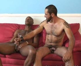 See these two muscular gay guys masturbating each others cock